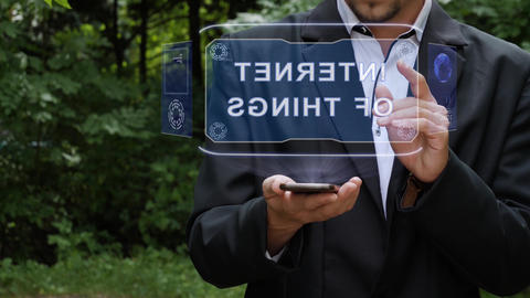 Businessman uses hologram with text Internet of things Footage