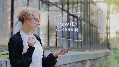 Blonde uses hologram Activate your brain Footage