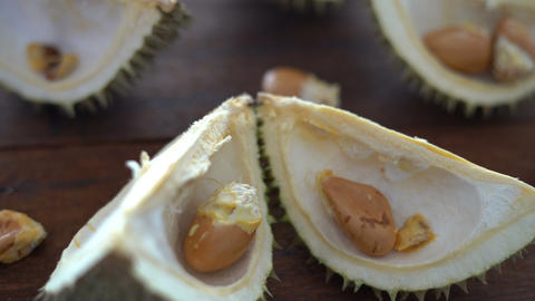 Leftover durian, shells and seeds on table Live Action