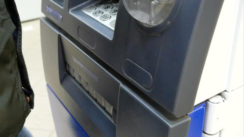 a person receives money from an ATM Footage