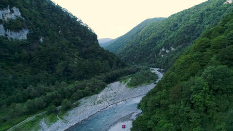 Green mountain valley is a river in a mountain gorge. Camping on the river Bank Live Action