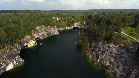 Aerial view. Flying over the Marble Canyon. Ruskeala. Karelia. 4K Footage