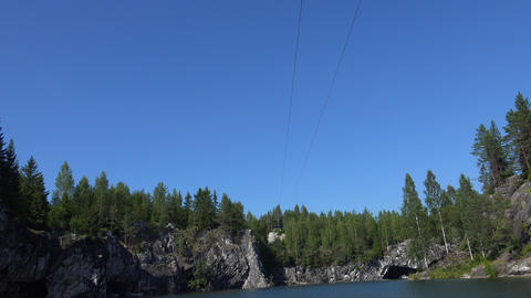 Zip-line. Ropes course, over water. Flying Fox. Marble Canyon. 4K Footage