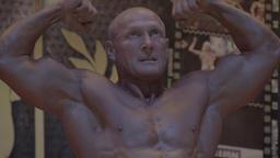 Male bodybuilder shows her body Footage