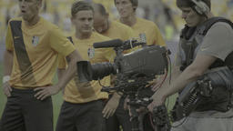 Cameraman with a camera on the Steadicam shoots during the TV broadcast at the s Footage