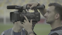 Cameraman with a camera in the stadium during the match Footage