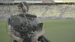 Cameraman with a camera on the stadium Footage