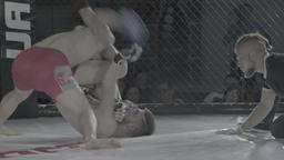 MMA fight in the cage between the two athletes Footage