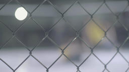 Silhouettes of MMA fighters who fight in a cage . Oktagon. MMA Footage