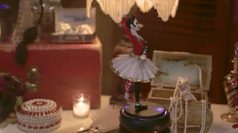 Halloween concept with ballerina music box and other objects Live Action