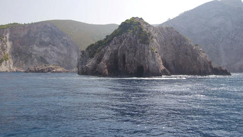 View from a boat at the Greek shore covered with rocks Footage