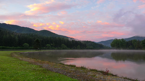 Foggy Sunrise in Mountain Forest Lake. Time Lapse 4K Footage