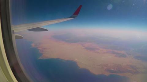 Seeing coastline through airplane window Footage