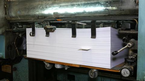 Printed paper is laid in pile Footage