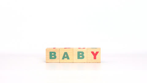 Word baby comes out of letters on wooden cubes Footage