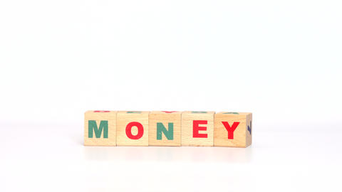 Letters on cubes make up money word Footage