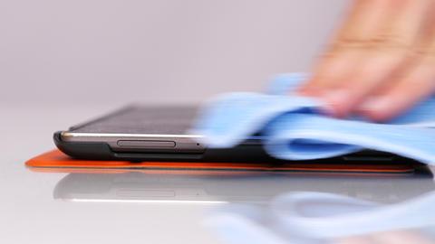 Wipe screen of tablet Footage