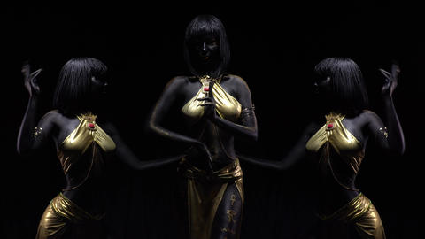 Editing, young woman with black and gold body art posing on black background, 4k Live Action