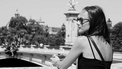 Beautiful French girl on a sightseeing trip to Paris Footage