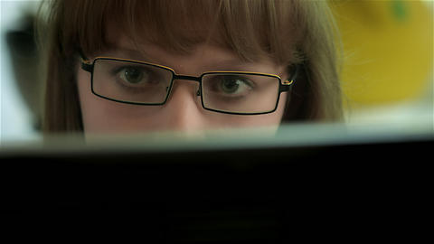 1080p Girl With Eyeglasses Looks Into Computer Monitor Footage