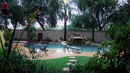 Establishing Shot of Residential Arizona Backyard Pool in a Monsoon