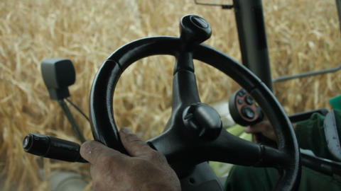 In the cab of combine harvester gathering corn Footage