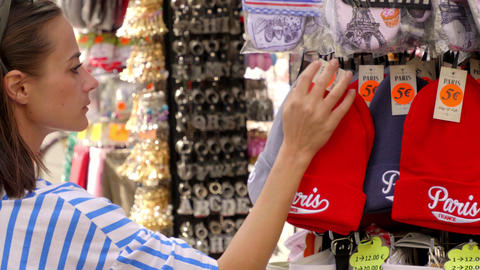 Young woman seeking for souvenirs on her trip to Paris - PARIS, FRANCE - JULY 29 Footage