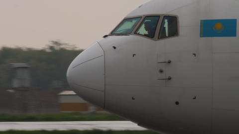 Widebody airplane landing at rainy weather Live Action