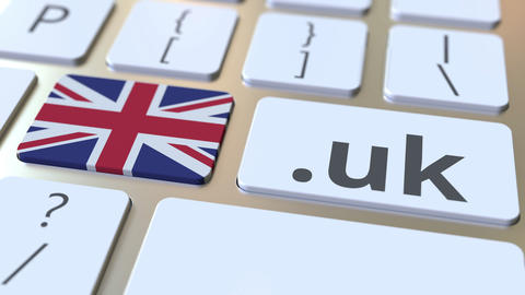 British domain .uk and flag of the UK on the buttons on the computer keyboard Live Action