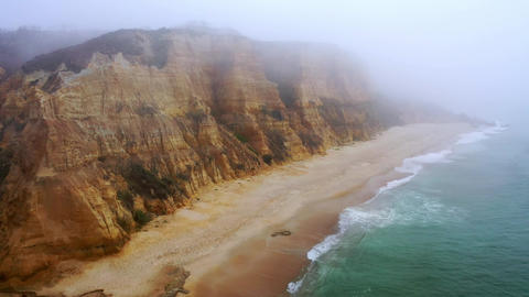 Flight over Furado beach in Portugal at the Atlantic Ocean Live Action