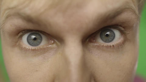 Close-up of a surprised emotional man with blue eyes looking into the camera Live Action