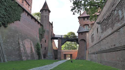 Malbork castle. Pathway (old moat) between middle and…, Live Action