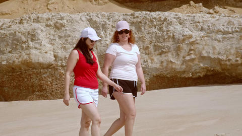 A carefree relaxing day at the beach - beautiful girls on summer holiday Live Action