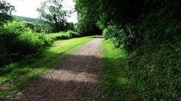 Smooth motion along an English countryside walkway and bridlepath Footage