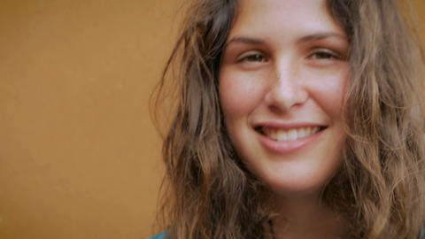 Close up portrait of a young attractive woman with long brown hair and freckles Footage