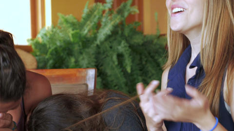 A group of young attractive female students laughing and joking while studying t Footage