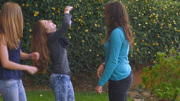Teenage girls laughing and playing outside in slow motion Footage