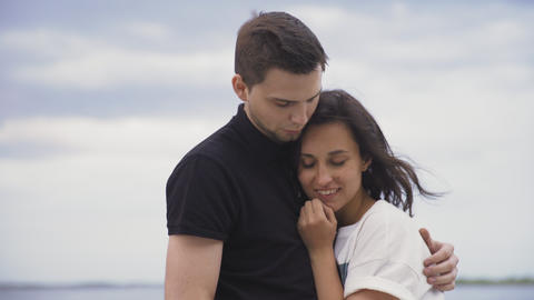 Romantic young couple hugging in park at the sky on background Footage
