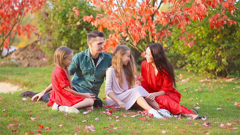 Portrait of happy family of four in autumn Live Action