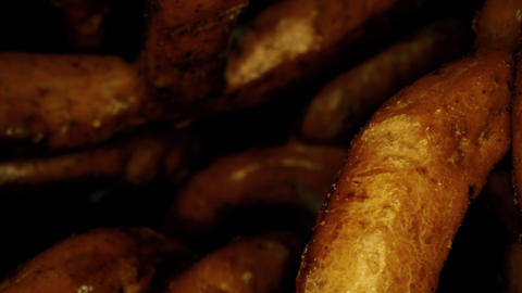 A pile of small bretzels or pretzels, a type of German baked bread, macro dolly Footage