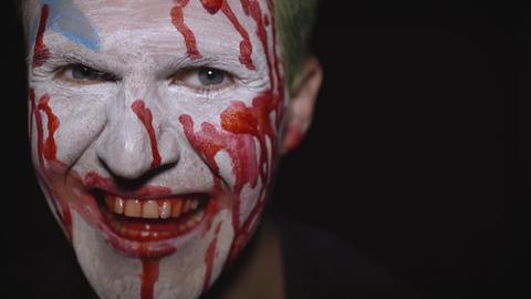 Clown Halloween man portrait. Creepy, evil clowns blood face. White face makeup Footage