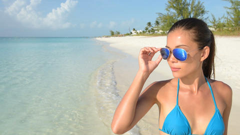 Beach bikini woman wearing fashion sunglasses eye wear Live Action