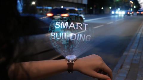 Unrecognizable woman with hologram Smart building Live Action