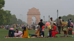 Family sitting in park at India Gate,New Delhi,India Footage