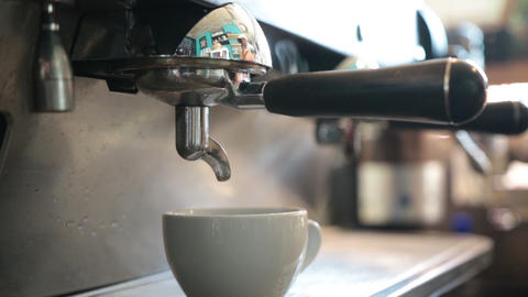 Young barista preparing coffee in a cafe Footage