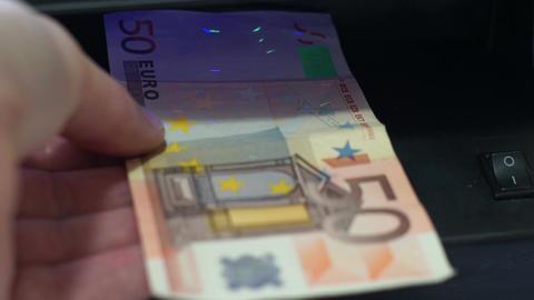 Fifty Euro EU Money Blacklight Counterfeit Check Closeup Footage