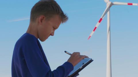 Student drawing windmill on tablet, alternative education Footage