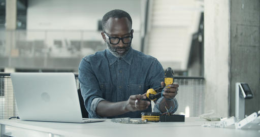 African American adult male working on robotics Live Action