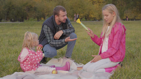 Bearded caucasian man shouting at his elder daughter on the autumn meadow Live Action