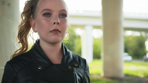 Closeup Girl Fasten with Zipper on Leather Jacket Footage